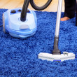 Vacuum cleaner in action - men cleaner a carpet. — Stock Photo #6226241