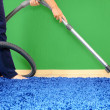 Vacuum cleaner in action - men cleaner a carpet. — Stock Photo #6226492