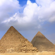 Great Pyramids, located in Giza, the pyramid of Pharaoh Khufu, Khafre and M - Stock Photo