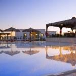 Early morning near the pool. Sunrise. — Stock Photo #6234155