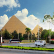 Ancient Great Pyramids and present day of Giza town,suburb of Cairo city. E - Photo