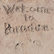 "Inscription ""Welcome to Paradise"" on beach. — Foto Stock"