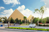Ancient Great Pyramids and present day of Giza town,suburb of Cairo city. E — Stock Photo