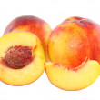 A few peaches with slice of one,on white.Isolated - Stock Photo