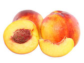 A few peaches with slice of one,on white.Isolated — Stock Photo