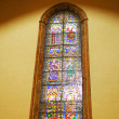 Stained-glass window in Catholic temple. Rome — Stock Photo #6361061