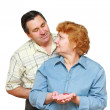 Old couple,wife hold a small heart. — Stock Photo