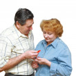 Old couple,husband gives to her a small heart. — Stock Photo