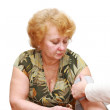 Old woman measures arterial pressure. — Stock Photo