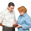 Stock Photo: Pensioners with regret face. In hadns-empty wallet