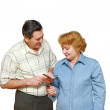 Stock Photo: Old a married couple look at the pension ID's.