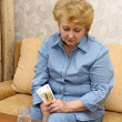 Senior lady woman with medication pills - Stock Photo