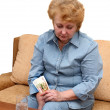 Senior lady woman with medication pills. - Stock Photo