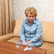 Stock Photo: Senior lady woman with medication pills.