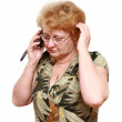 Senior lady speaks by a mobile phone. - Foto de Stock  
