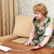 Royalty-Free Stock Photo: Old woman measures arterial pressure.