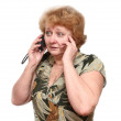 Senior lady speaks by a mobile phone. - Stock Photo