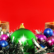 New Year decoration-balls ,candels on red. - Stockfoto