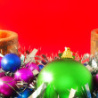 Royalty-Free Stock Photo: New Year decoration-balls ,candels on red.