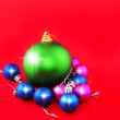 Christmas,New Year decoration-balls .On the red. — Stock Photo