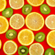 Background texture-fruit mix on red background. - Stock Photo