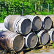 Wine barrels stacked. Italy - Stock Photo