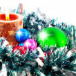 New Year decoration- balls, tinsel, candels. - Stockfoto