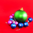 Christmas,New Year decoration-balls .On the red. — Stock Photo #6513756