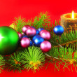 New Year decoration-balls ,candels on red. — Stock Photo #6513783