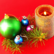 New Year decoration-balls ,candels on red. — Stock Photo