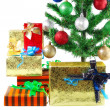 Fragment of New Year Tree with gift boxes — Stock Photo #6513889