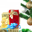 Fragment of New Year Tree with gift boxes — Стоковая фотография