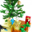 Fragment of New Year Tree with gift boxes - Stock Photo