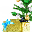 Fragment of New Year Tree with gift boxes - Foto Stock