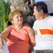 Mature couple near palm-tree. — Stock Photo
