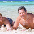 Mature couple on the beach in the tropics. — Stock Photo #6514123