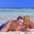 Mature couple on the beach in the tropics. — Stock Photo #6514125