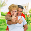 Elderly couple showed up  thumbs All just fine! — Stock Photo