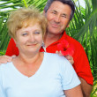 Elderly couple near the palm-tree. — Stock Photo #6514167