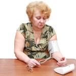 Senior lady measures arterial pressure. — Stock Photo #6514344