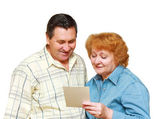 Old couple look at family picture with gladness. — Stock Photo