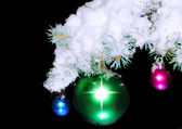 Balls with snow-covered fir branches. — Stock Photo