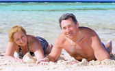Mature couple on the beach in the tropics. — Photo