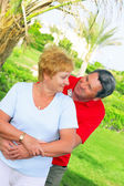 Elderly couple playfully looks at each other. — Stock Photo