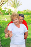"""Elderly couple showed up thumbs All just fine!"""" — Stock Photo"""