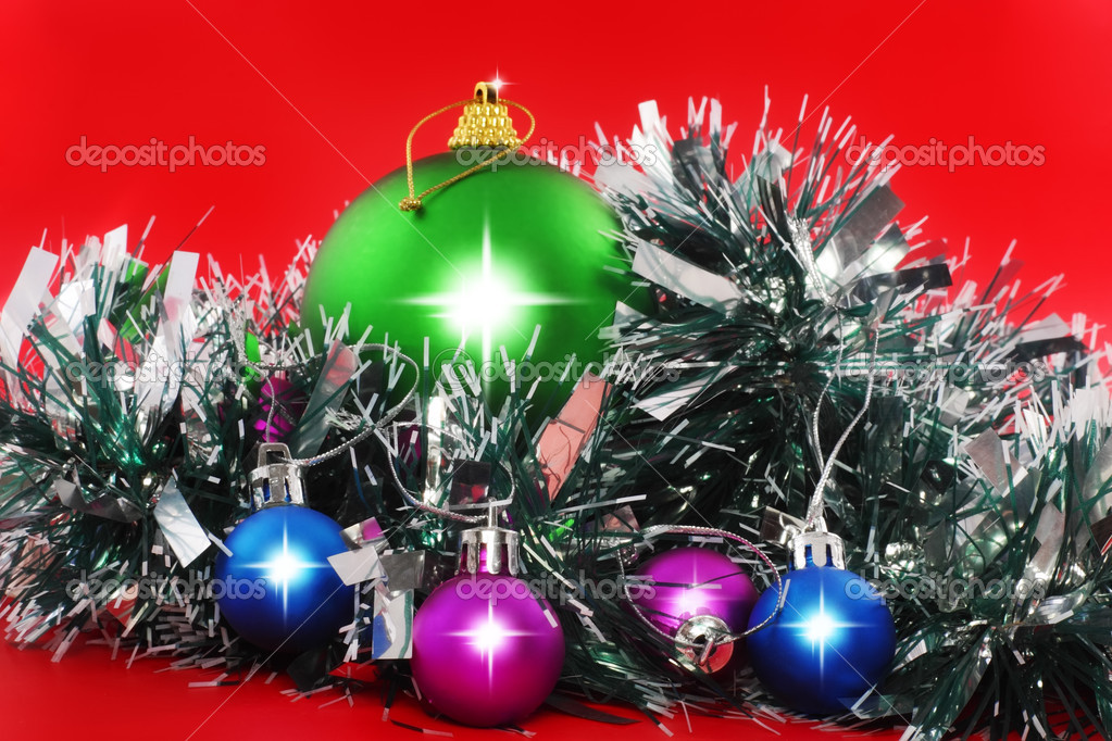 Christmas and and New Year decoration- balls, tinsel .On the red background. — Stock Photo #6513760