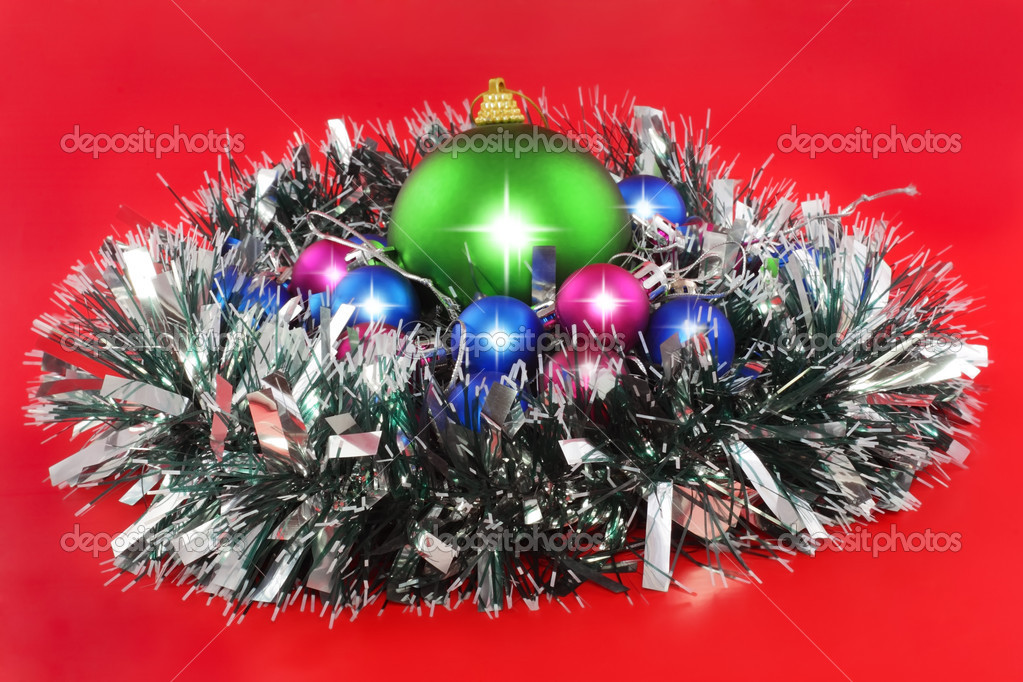 Christmas and and New Year decoration- balls, tinsel .On the red background. — Stock Photo #6513771