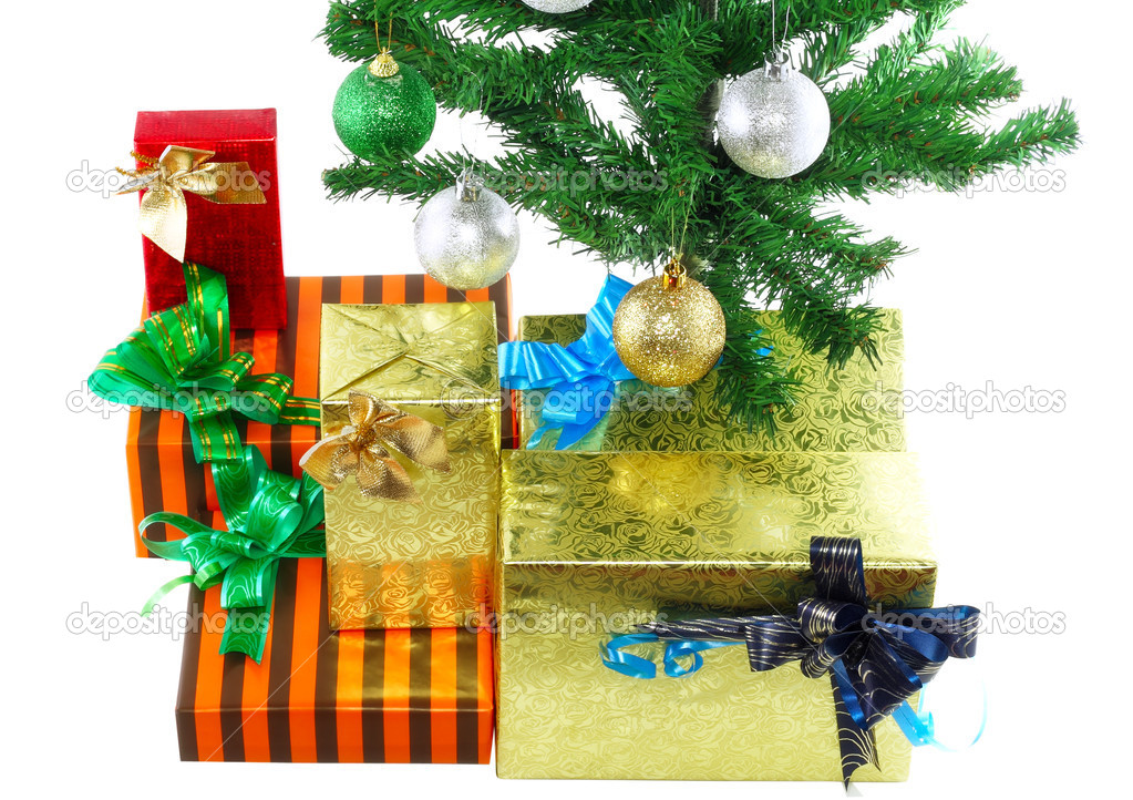 Fragment of Christmas and New Year Tree with gift boxes. Isolated over white background. — Stock Photo #6513961
