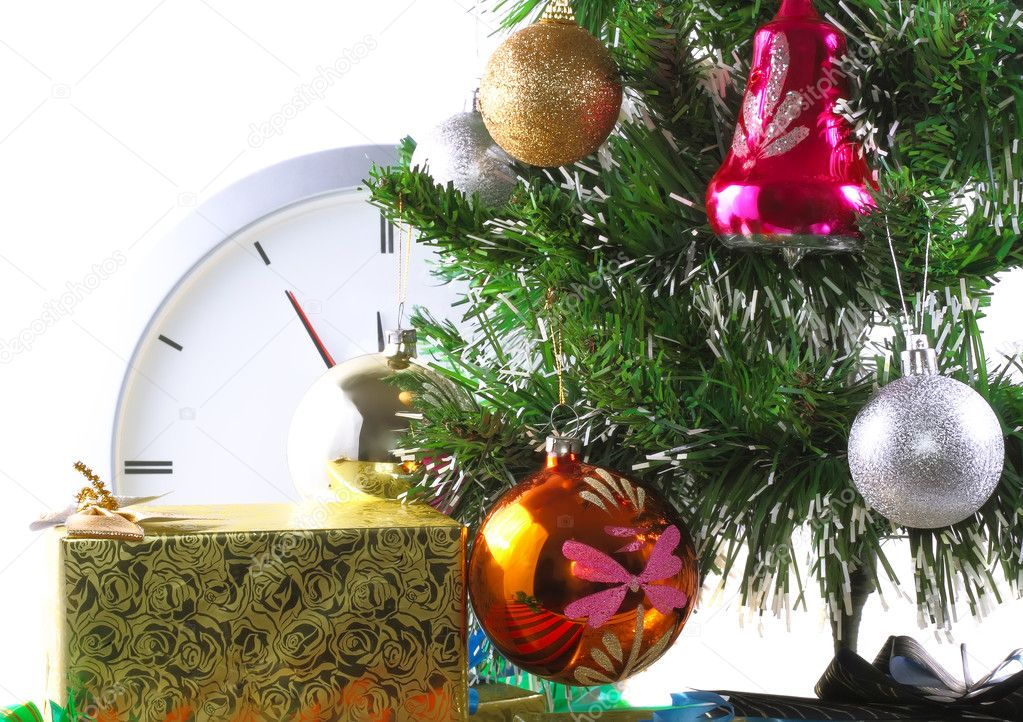 New Year and Christmas Tree and gift boxes, clock . Isolated over white background.  Stock Photo #6514088