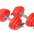 Stock Photo: Sporting equipment - two red dumbbells. Isolated